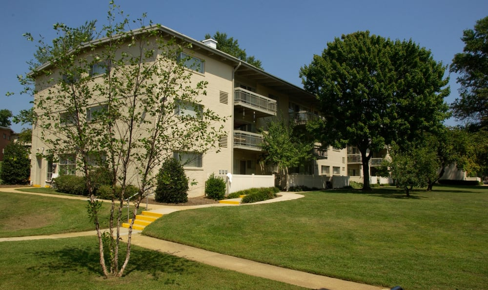 Pathways and mature trees outside resident buildings at Watergate Pointe in Annapolis, Maryland