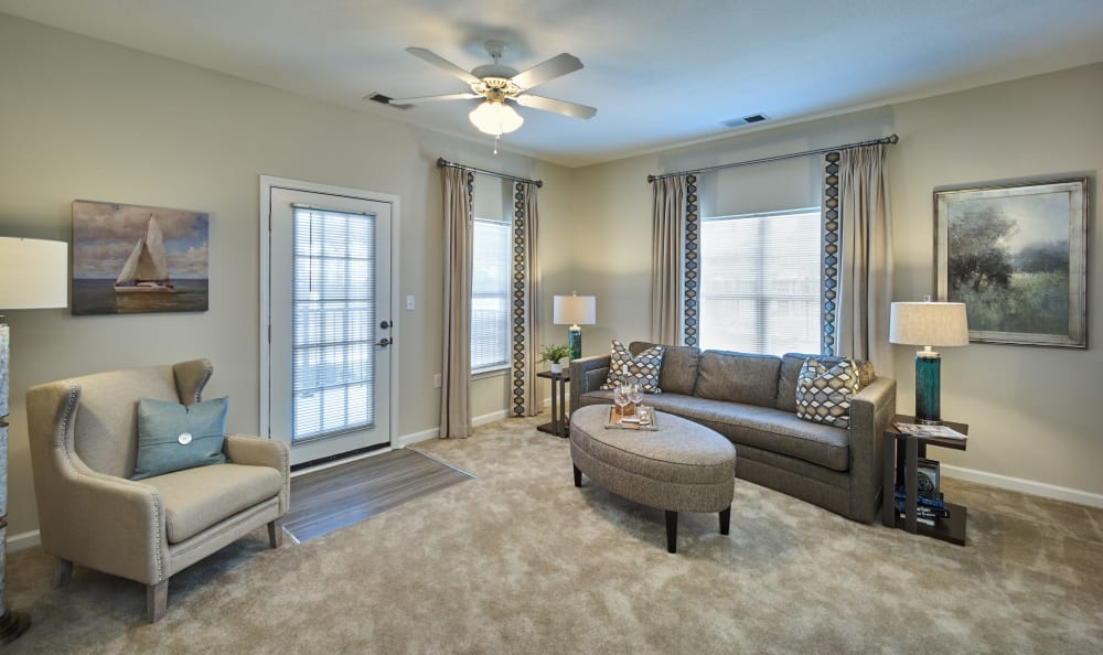 Large living room with ceiling fan at Meridian Obici in Suffolk, Virginia