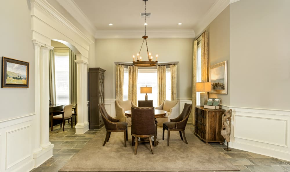 Beautiful clubhouse interior with dining room seating at Meridian Obici in Suffolk, Virginia