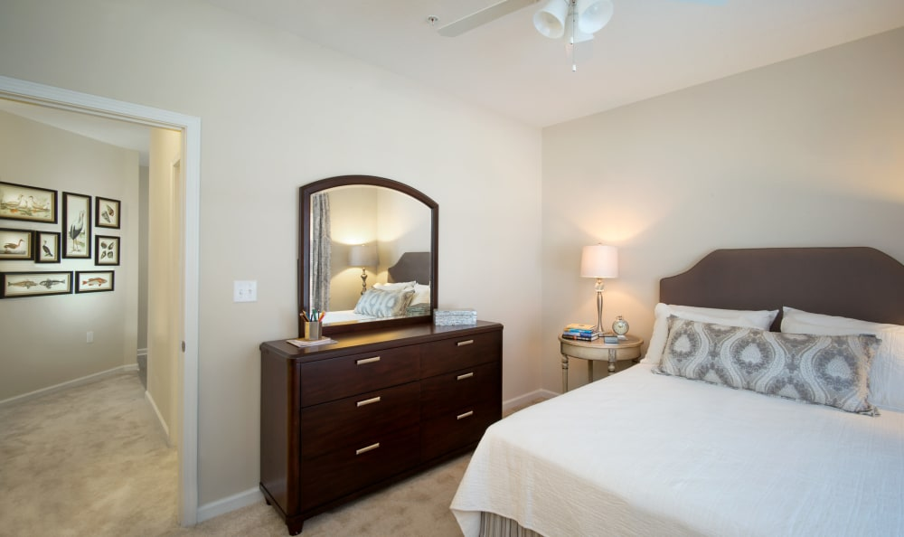 Beautifully decorated master bedroom in model home at Meridian Obici in Suffolk, Virginia