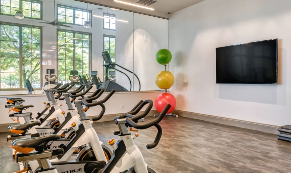 Spin bike room with a flat-screen TV at Harbor Pointe in Bayonne, New Jersey