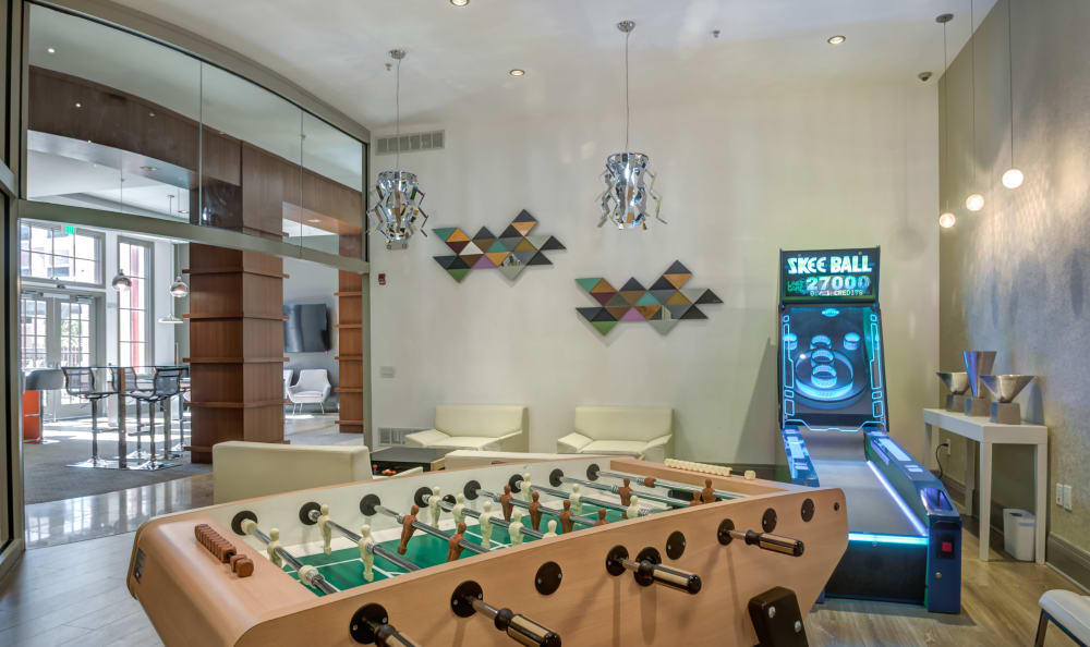 Community game room with foosball and skee ball at Harbor Pointe in Bayonne, New Jersey