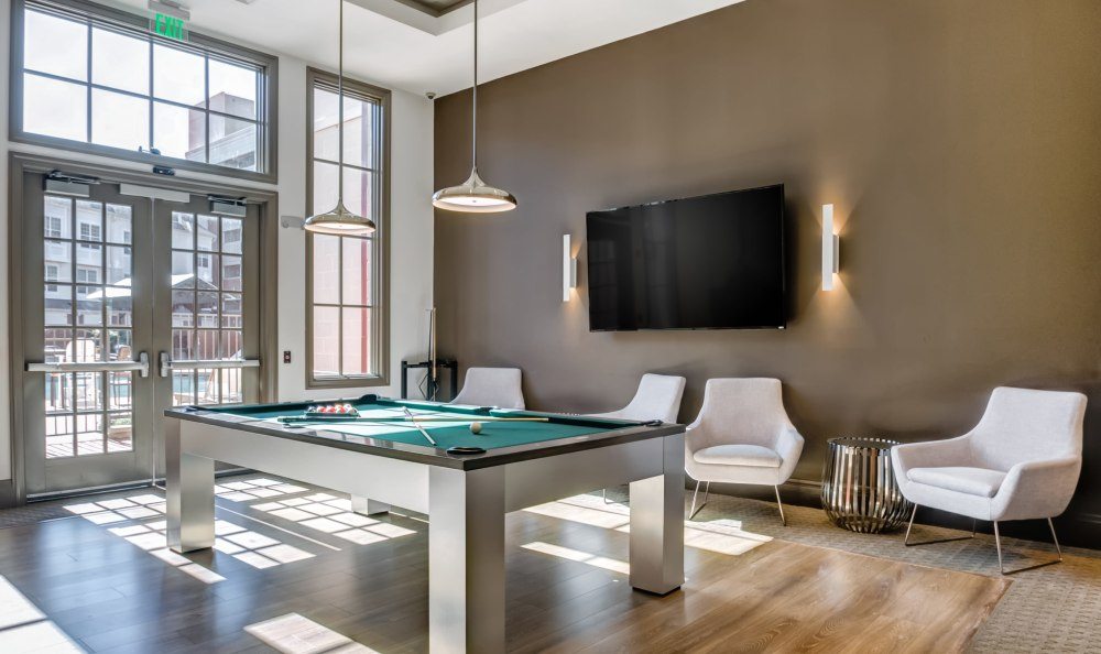 Large billiards room with a flat-screen TV at Harbor Pointe in Bayonne, New Jersey