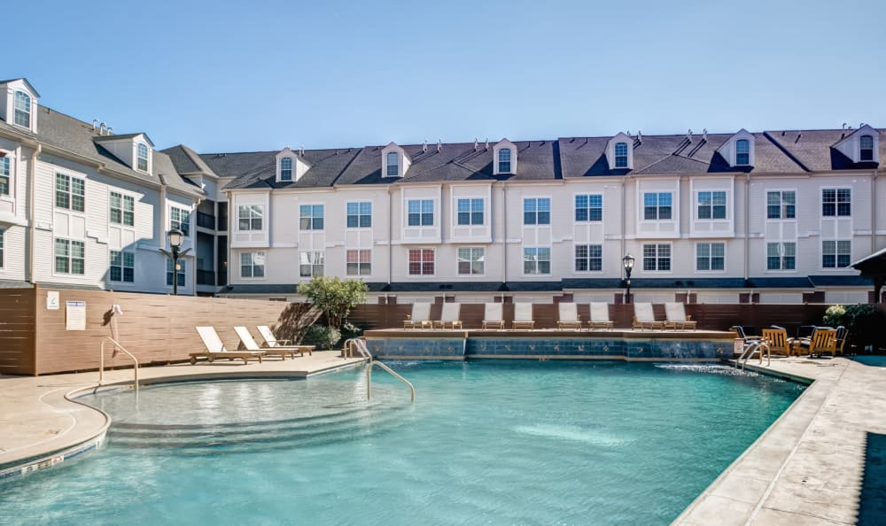 Resort-style pool with sundeck and ample lounge chairs at Harbor Pointe in Bayonne, New Jersey