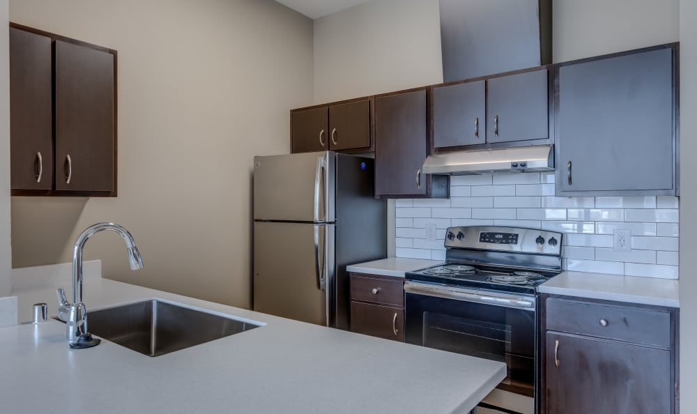 Spacious kitchen with stainless-steel appliances at Lumen Apartments in Everett, Washington