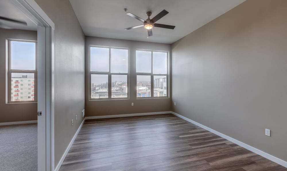 Living room with a ceiling fan at Lumen Apartments in Everett, Washington