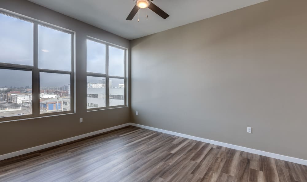 Large living room windows for a gorgeous city view at Lumen Apartments in Everett, Washington