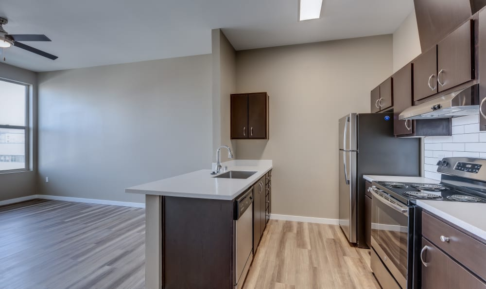 Spacious kitchen with a breakfast bar at Lumen Apartments in Everett, Washington