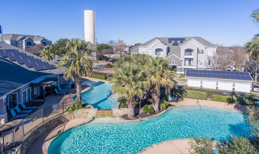Aerial view of resort-style pool at Sage at 1825 Apartments in Pflugerville, Texas