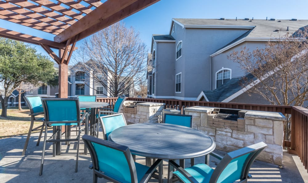 Outdoor clubhouse seating for summer fun at Sage at 1825 Apartments in Pflugerville, Texas