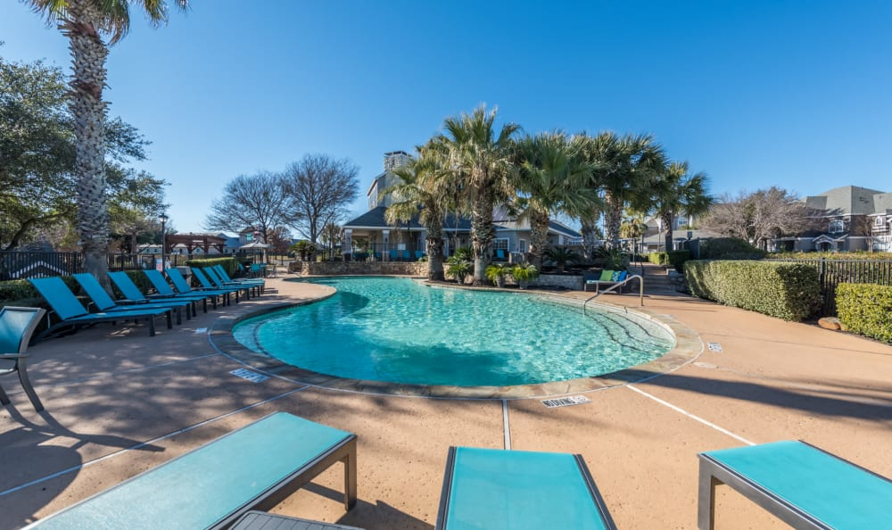 Sundeck with ample lounge chairs at Sage at 1825 Apartments in Pflugerville, Texas