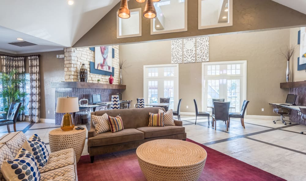 Spacious clubhouse with comfortable seating at Sage at 1825 Apartments in Pflugerville, Texas