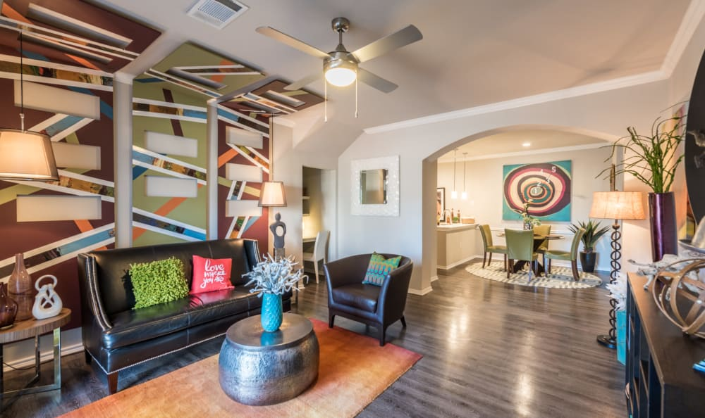 Contemporary decorated living room in a model home at Sage at 1825 Apartments in Pflugerville, Texas