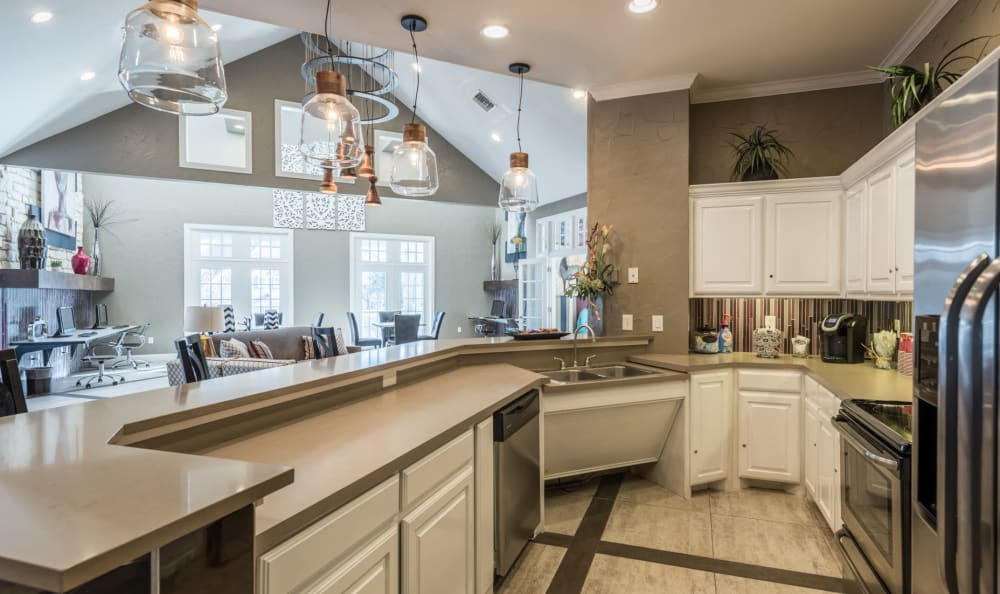 Large clubhouse kitchen for entertaining guests at Sage at 1825 Apartments in Pflugerville, Texas