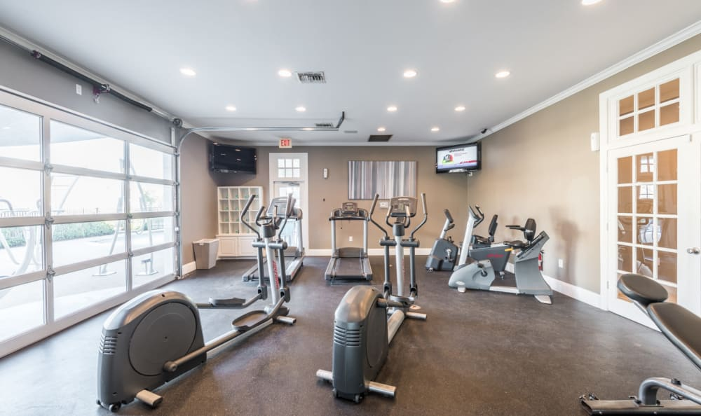 Community fitness center with individual work out stations at Sage at 1825 Apartments in Pflugerville, Texas