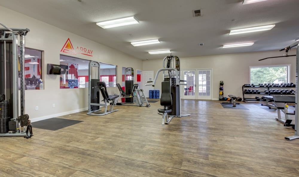 Fitness center with a weight set at Array Apartments in Austin, Texas