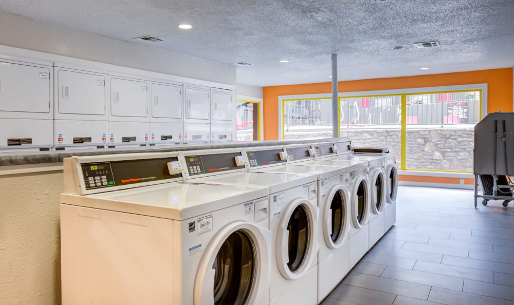 Community laundry room with plenty of washer and dryers at Array Apartments in Austin, Texas