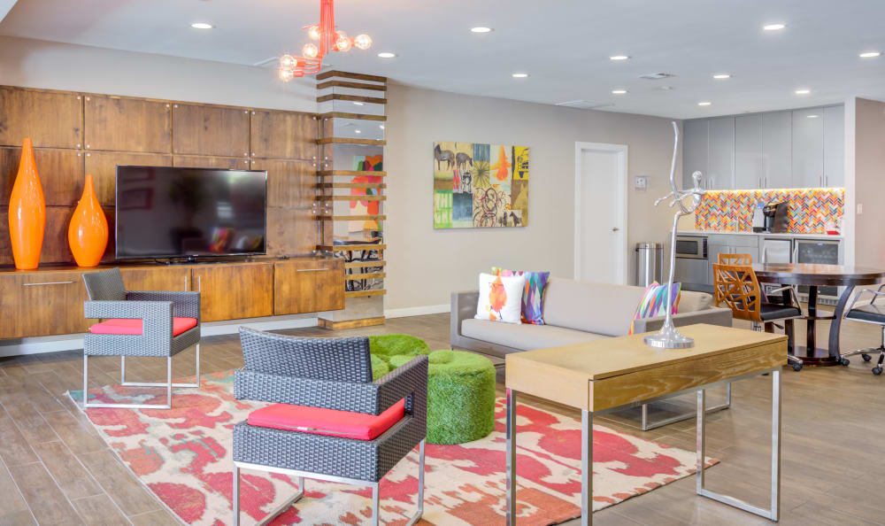 Decorated resident lounge with a flat-screen TV at Array Apartments in Austin, Texas