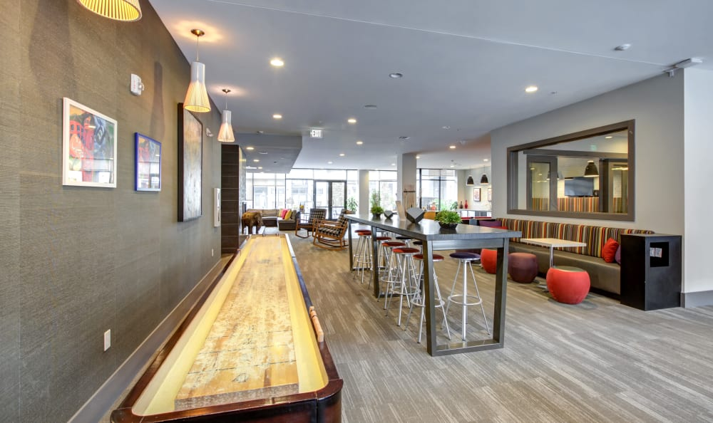 Shuffleboard and more in the game area of the resident clubhouse at Regatta Sloan's Lake in Denver, Colorado