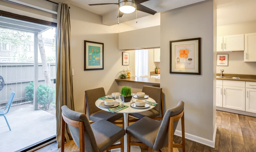 Dining area next to the sliding door to a model home's private patio at The Ranch at Bear Creek Apartments & Townhomes in Lakewood, Colorado