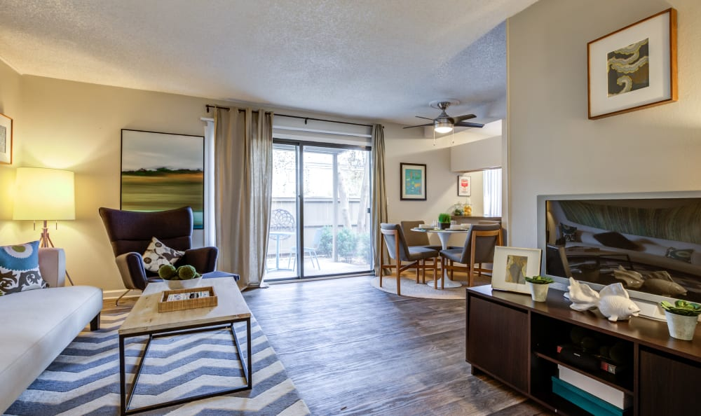Spacious open-concept floor plan in a model home at The Ranch at Bear Creek Apartments & Townhomes in Lakewood, Colorado
