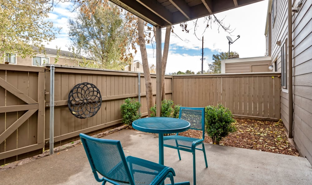 Large private patio outside a model home at The Ranch at Bear Creek Apartments & Townhomes in Lakewood, Colorado