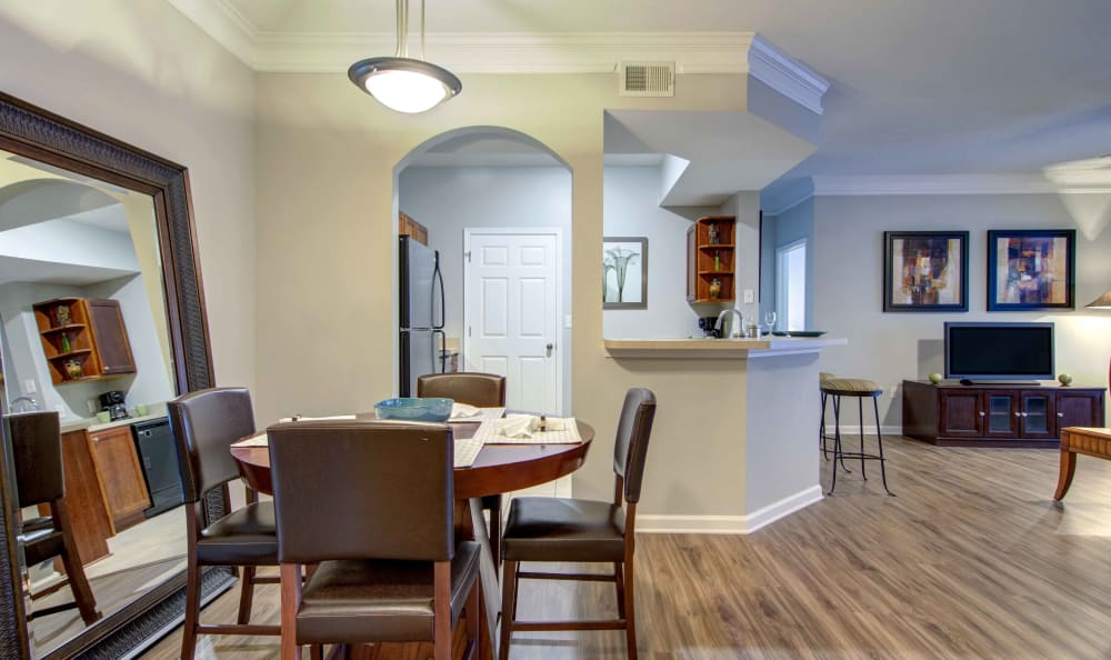 Partial view of the kitchen and living areas from the dining nook of a model home at Landing Square in Atlanta, Georgia
