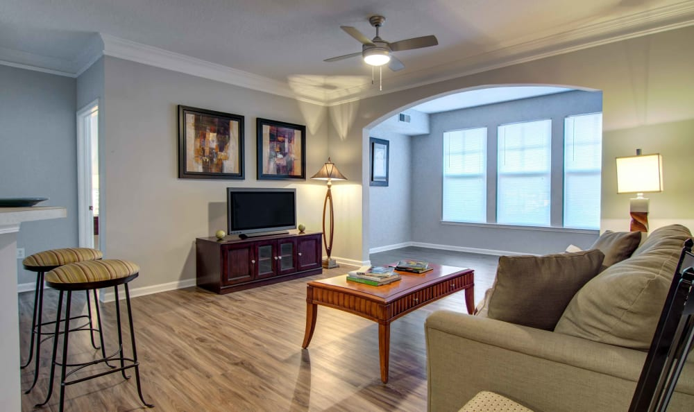Ceiling fan and hardwood floors in the living area of a model home at Landing Square in Atlanta, Georgia