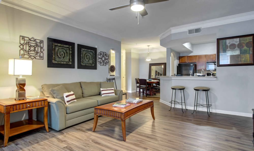 Spacious open-concept layout with hardwood floors in a model home at Landing Square in Atlanta, Georgia