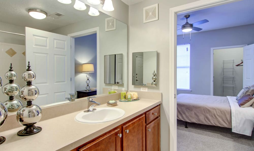 Partial view of the master bedroom from the en suite bathroom of a model home at Landing Square in Atlanta, Georgia
