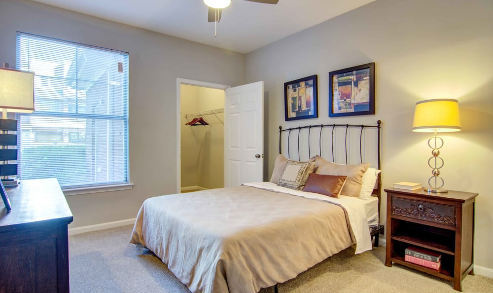 Well-decorated master bedroom with a ceiling fan in a model home at Landing Square in Atlanta, Georgia