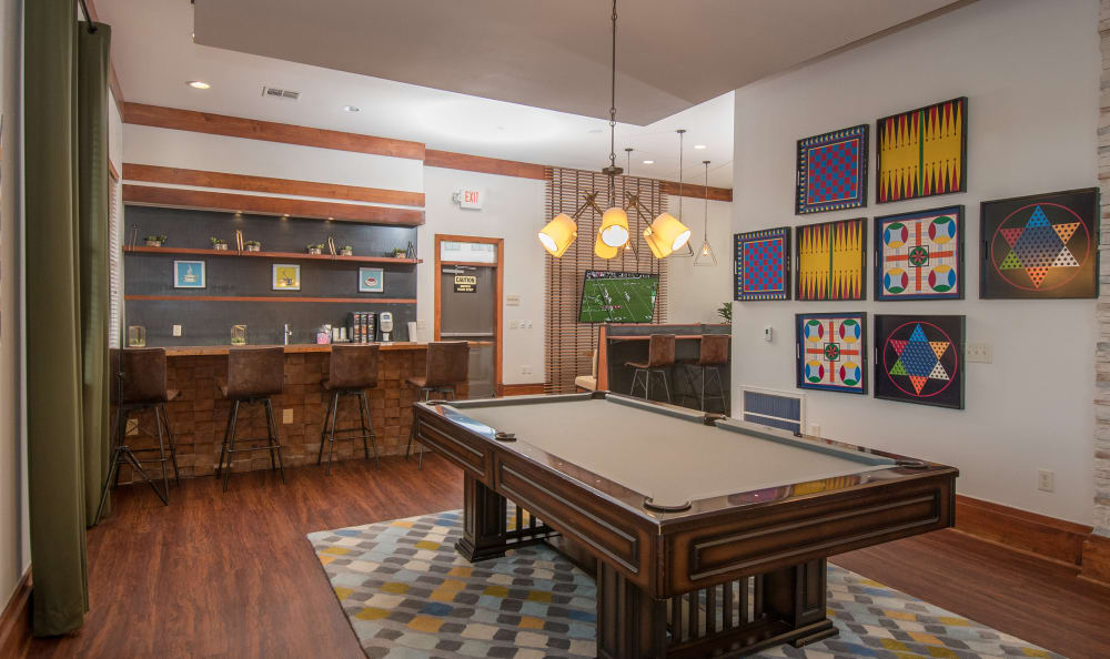Clubhouse with ample seating and billiards table at Villas Tech Ridge in Pflugerville, Texas