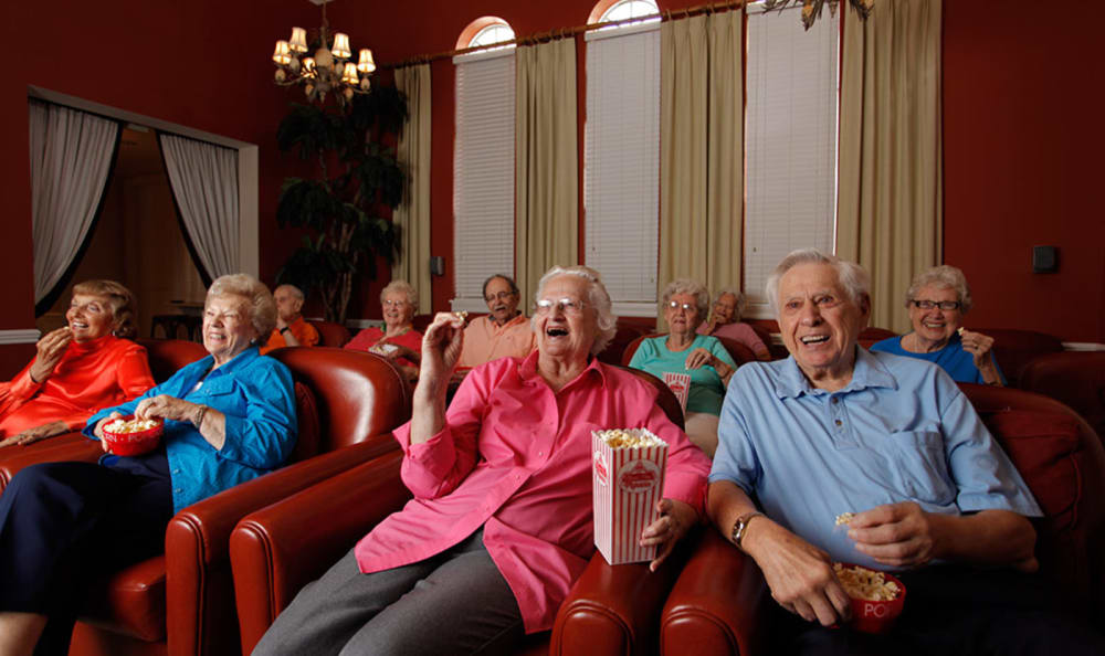 Residents enjoying a movie and popcorn at Tequesta Terrace in Tequesta, Florida