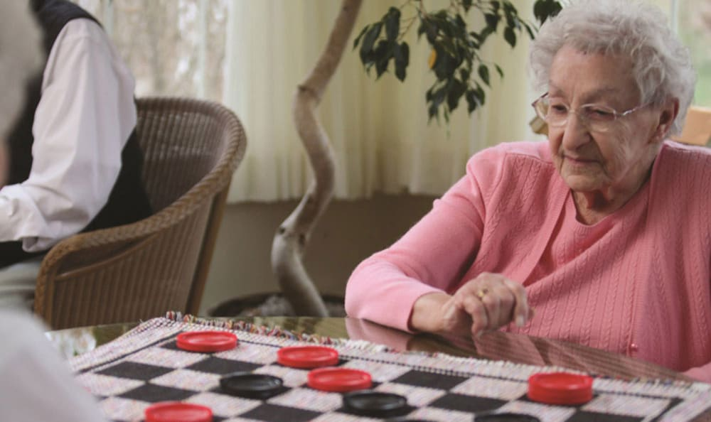 Residents playing checkers at Valley Terrace in White River Junction, Vermont
