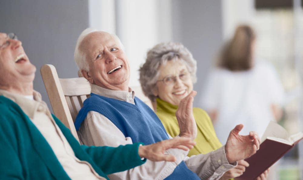 Residents laughing together at Wheelock Terrace in Hanover, New Hampshire