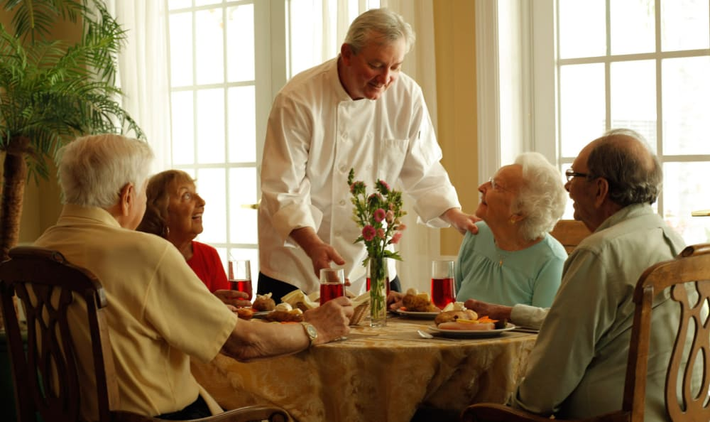 Chef visiting with residents at Woodstock Terrace in Woodstock, Vermont