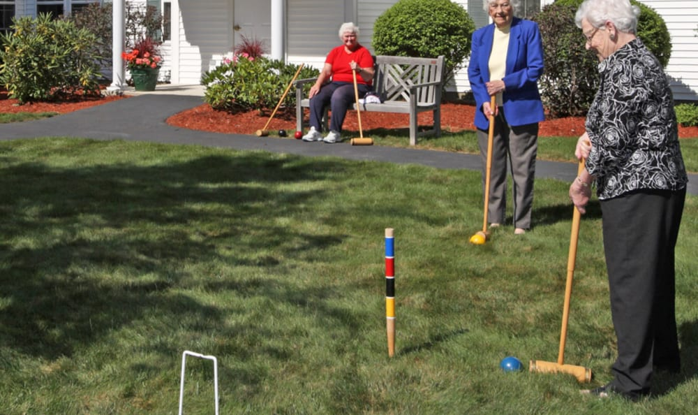 Residents playing lawn games outside at Woodstock Terrace in Woodstock, Vermont