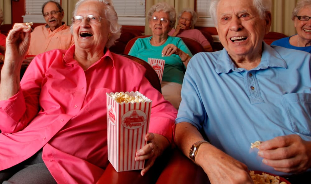 Residents enjoying popcorn and a movie at Woodstock Terrace in Woodstock, Vermont