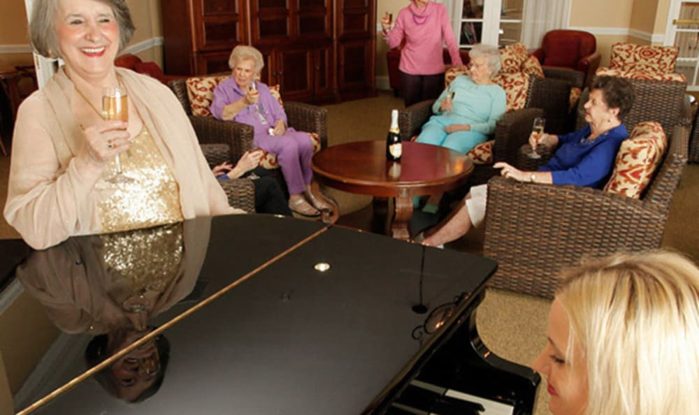Residents gathered around the piano at Woodstock Terrace in Woodstock, Vermont