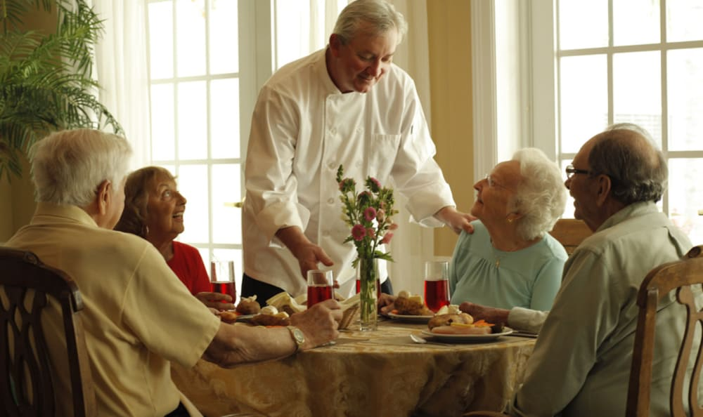 Chef visiting with residents at Scarborough Terrace in Scarborough, Maine