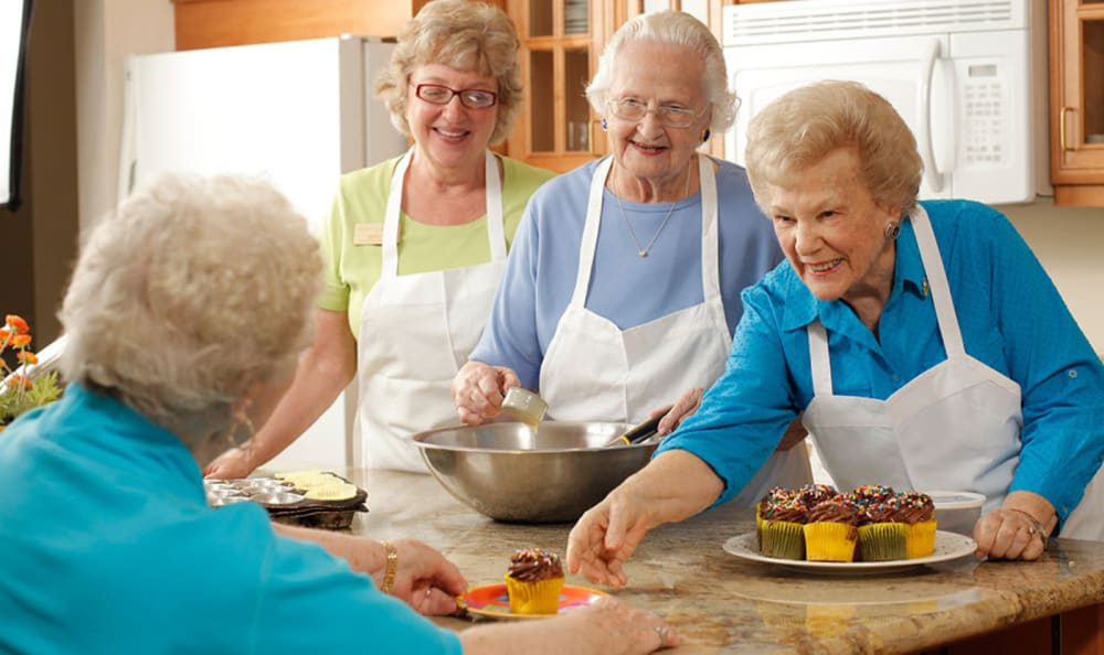 Residents cooking together at Scarborough Terrace in Scarborough, Maine