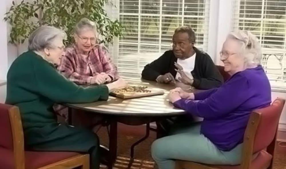 Residents playing games at Armour Oaks Senior Living Community in Kansas City, Missouri.