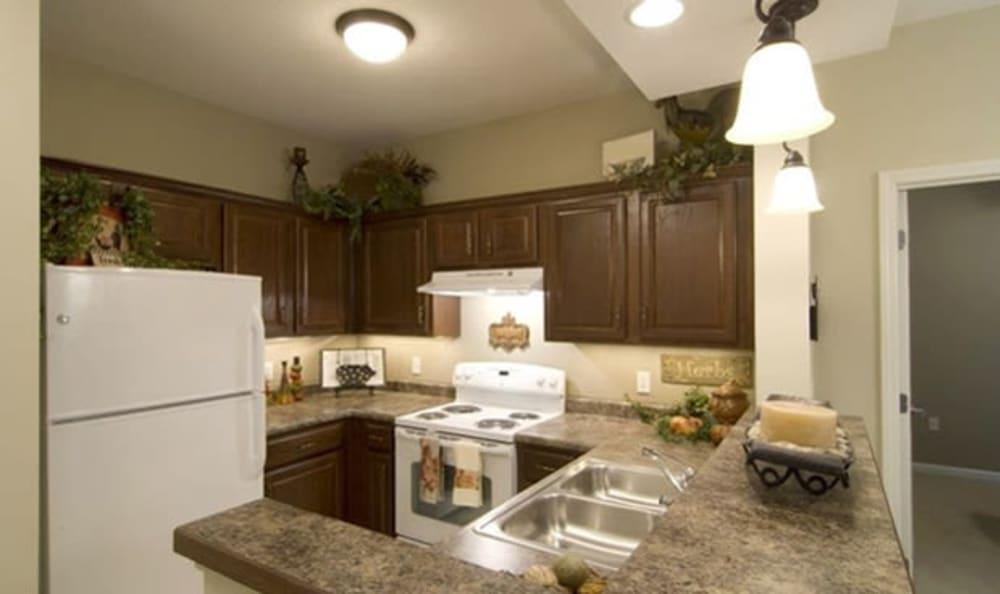 Resident kitchen at Armour Oaks Senior Living Community in Kansas City, Missouri.