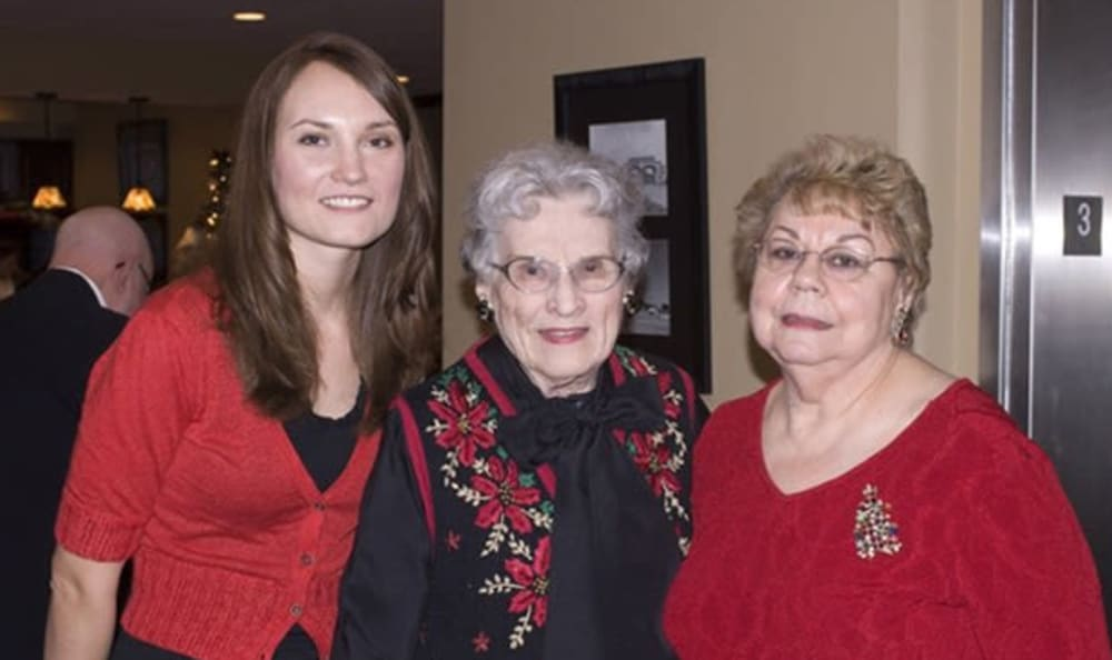 Residents and visitors at a holiday party at Armour Oaks Senior Living Community in Kansas City, Missouri.