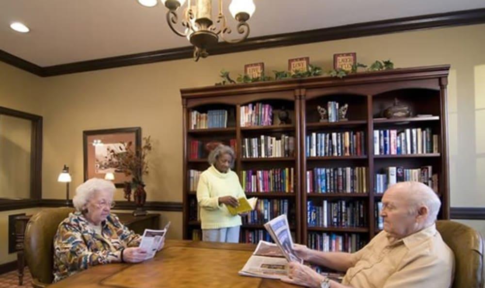 Residents reading at Armour Oaks Senior Living Community in Kansas City, Missouri.