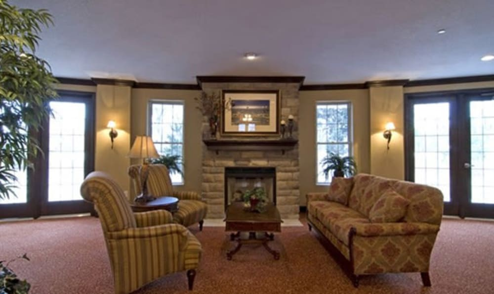 Lounge with a fireplace at Armour Oaks Senior Living Community in Kansas City, Missouri.