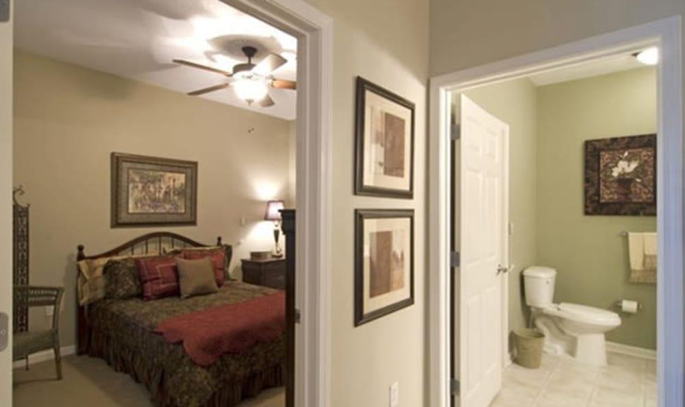Resident bedroom and bathroom at Armour Oaks Senior Living Community in Kansas City, Missouri.