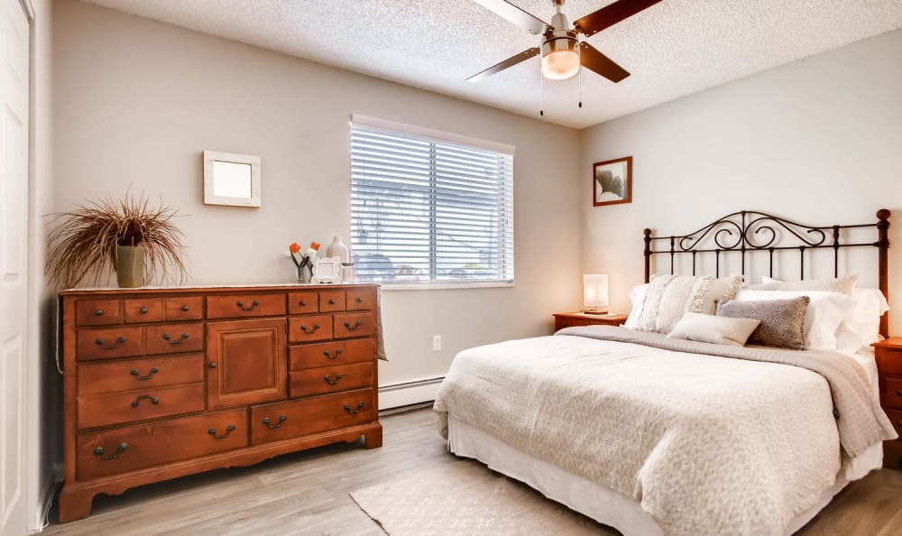 Large bedroom with ceiling fan at Mountain Vista in Lakewood, Colorado