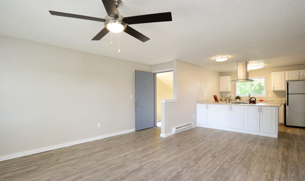 Open floor plan with kitchen at Discovery Landing Apartment Homes in Burien, WA