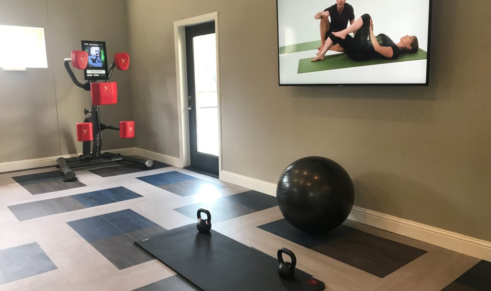 boxing machine and yoga fitness on demand area